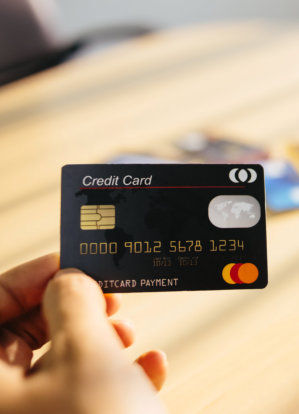 a photo of a hand holding a credit card