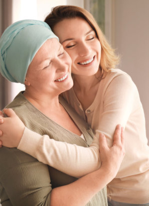 an adult woman hugging a senior woman