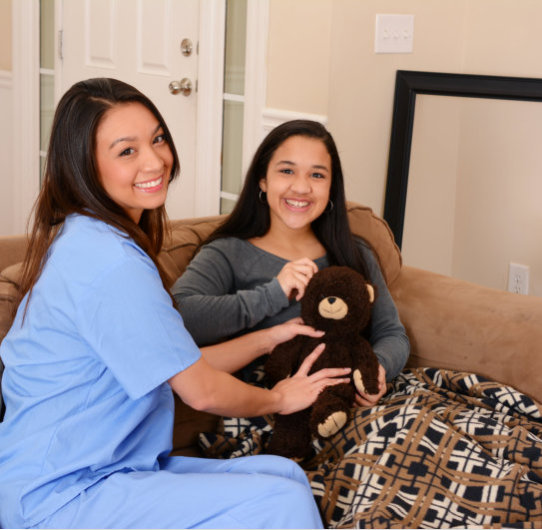 a photo of a caregiver with a teenager woman